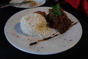 A pile of white rice and shredded beef on a white plate