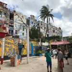 An alleyway flanked with mural-covered buildings