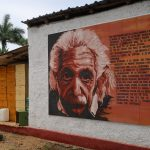 A large painted portrait of Albert Einstein's face on the side of a barn