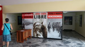 Sign with images of Fidel Castro and soldiers, along with patriotic slogans