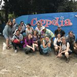 "17 people stand in front of a wall that says ""Coppelia"""